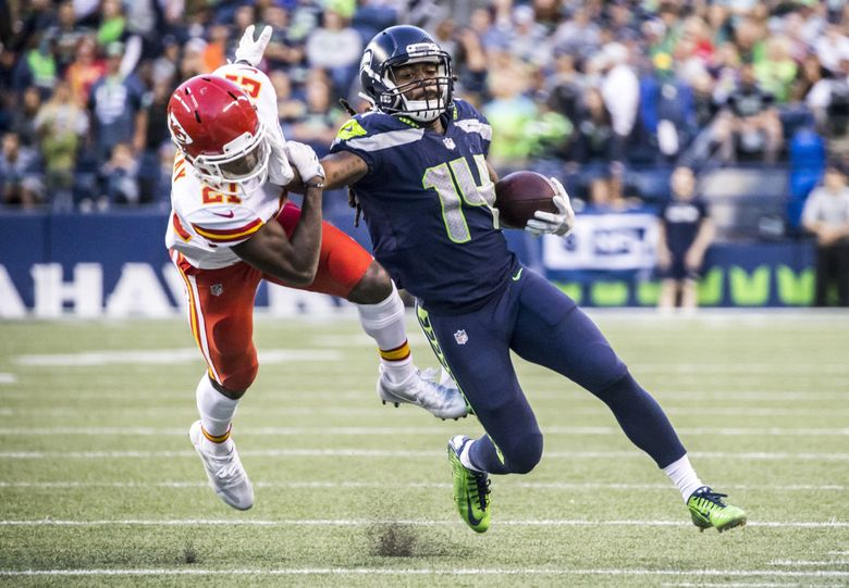 Seahawks running back J.D. McKissic strong-arms Chiefs cornerback Eric Murray in the fourth quarter. (Bettina Hansen / The Seattle Times)