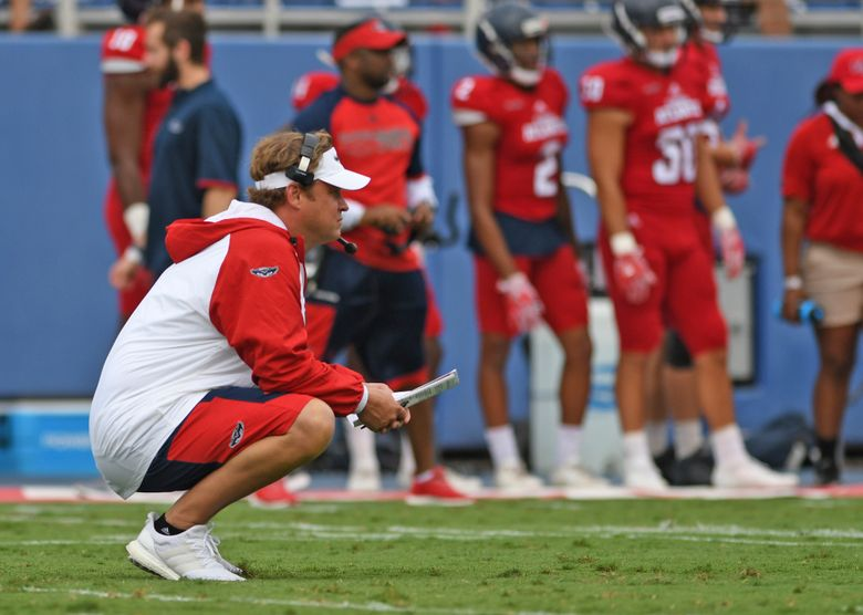 This photo taken April 22, 2017, shows new Florida Atlantic coach Lane Kiffin watching his players  in Boca Raton, Fla. Kiffin is trolling you. When Ole Miss parted ways with coach Hugh Freeze last month and Kiffin quickly followed a slew of Rebel-related accounts on Twitter, Florida Atlantic's coach did so knowing it would spark Lane-is-going-there talk. He orchestrated the worst hype video ever made back in the spring, because he knew a real one wouldn't get noticed. He had Miami Hurricanes legend Clinton Portis speak to FAU players in Owls gear. Those are just some of his recent highlights. ( Jim Rassol/South Florida Sun-Sentinel via AP)