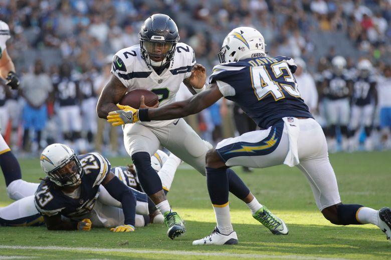 Seattle Seahawks quarterback Trevone Boykin (2) scores a touchdown during the first half of a preseason game last August.  (Jae C. Hong/AP)