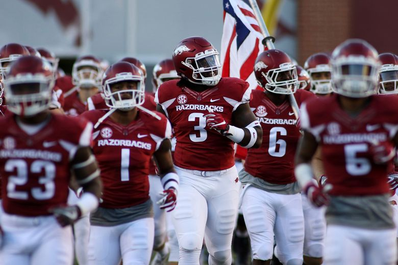 FILE – In a Saturday, Oct. 8, 2016 file photo, Arkansas' McTelvin Agim smiles as he runs out with the team before the start of an NCAA college football game against Alabama in Fayetteville, Ark. Agim started the final five games for the Razorbacks last season as a true freshman. Now 6-3 and 286 pounds, many expect him to use his quickness and power to approach an all-SEC level this season. (AP Photo/Samantha Baker, File)