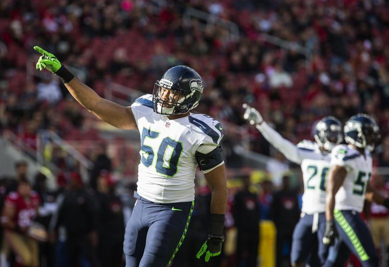 K.J. Wright and the Seattle defense celebrate a San Francisco fumble as the Seahawks played San Francisco 49ers Jan. 1, 2017 at Levi Stadium in Santa Clara. (Dean Rutz / The Seattle Times)