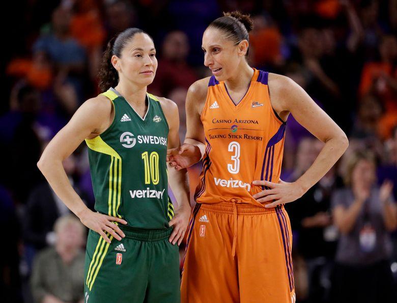 Phoenix Mercury guard Diana Taurasi (3) talks with Seattle Storm guard Sue Bird (10) during the second half of a single-game WNBA basketball playoff matchup on Wednesday. (Matt York/AP)