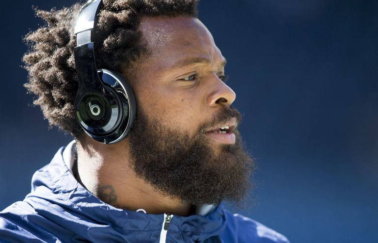 Seahawks defensive end Michael Bennett warms up before Seattle takes on the Kansas City Chiefs for a preseason game at CenturyLink Field in Seattle Friday August 25, 2017.  (Bettina Hansen / The Seattle Times)