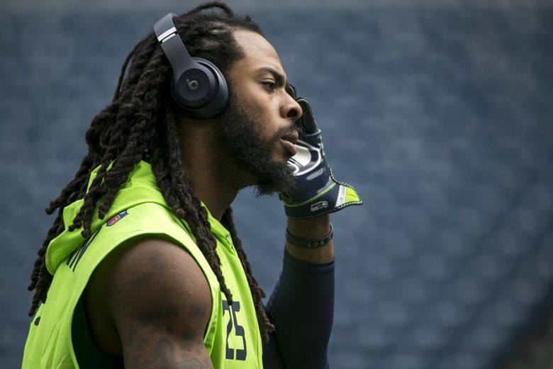 Seattle cornerback Richard Sherman warms up before the Seattle Seahawks take on the San Francisco 49ers for their home opener.  (Bettina Hansen / The Seattle Times)