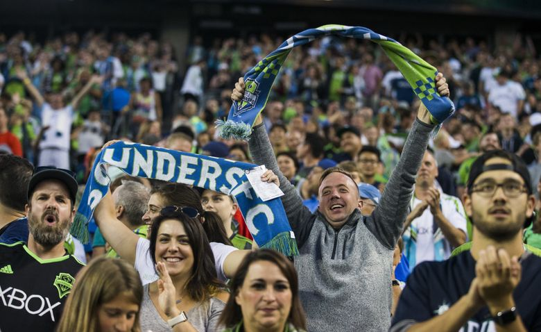 Ecstatic fans cheer after Sounders midfielder Gustav Svensson scored the equalizer in the 74th minute to tie the Sounders game 3-3 after they were down by 3-0 at the half to D.C. United on Wednesday, July 19, 2017 at Century Link Field. The Sounders won the game 4-3. (Kjell Redal/The Seattle Times)