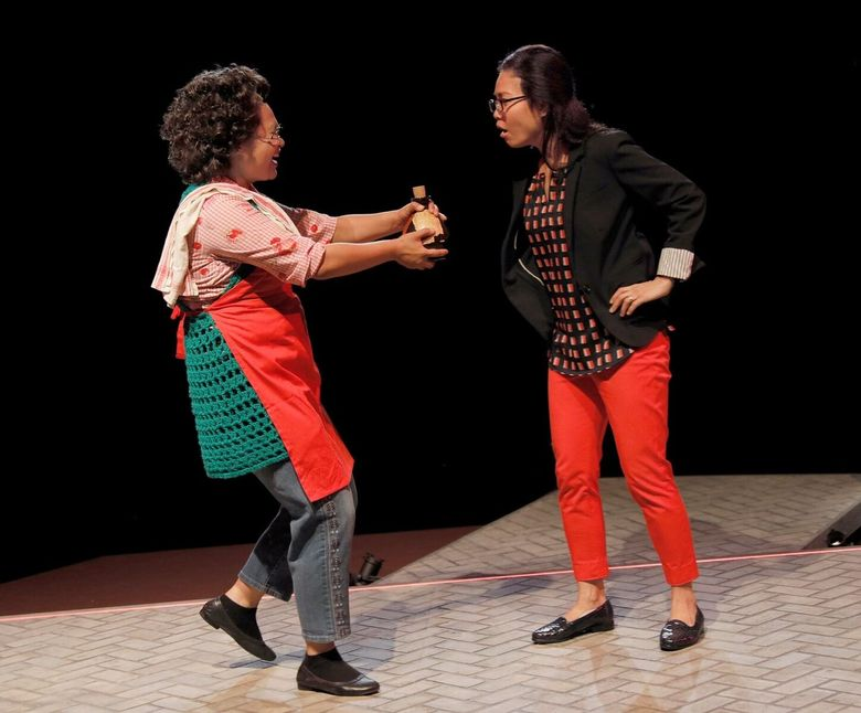 """Annelih GH Hamilton and Khanh Doan in """"King of the Yees"""" at ACT Theatre. (Chris Bennion)"""