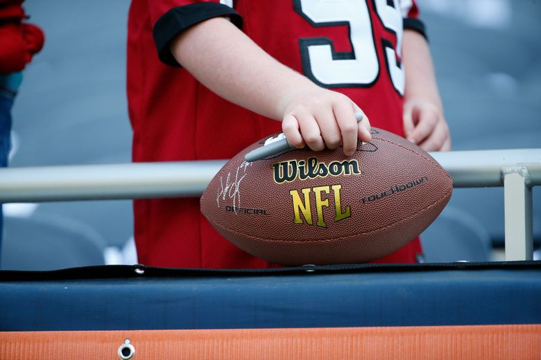 An Atlanta Falcons fan awaits player autographs before an NFL football game against the Chicago Bears Sunday, Sept. 10, 2017, in Chicago. (AP Photo/Nam Y. Huh)  (Nam Y. Huh/The Associated Press)