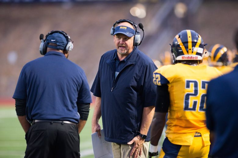 Bellevue  football coach Mark Landes prepares for a football game against Garfield last month. (Amanda Ray/Special to the Seattle Times)