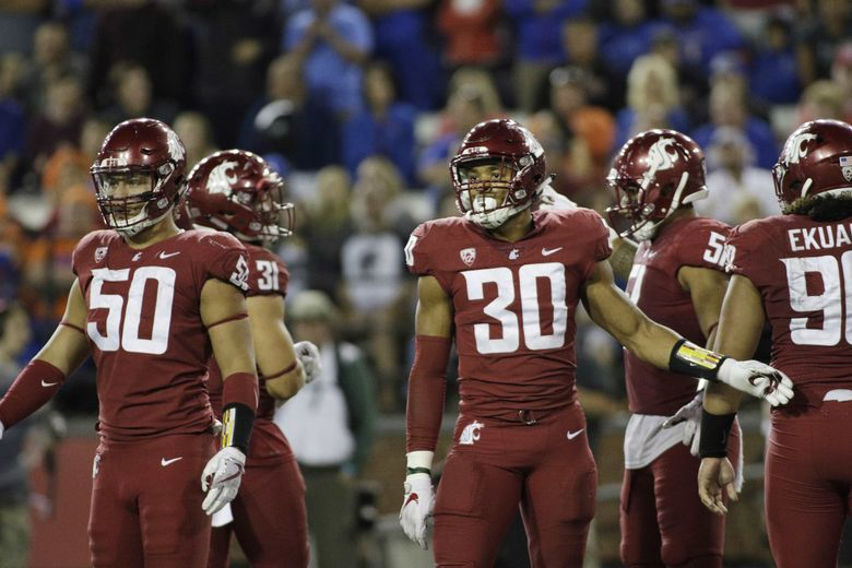 Washington State defensive lineman Hercules Mata'afa (50) and defensive lineman Nnamdi Oguayo (30) stand on the field during the second half of an NCAA college football game in Pullman, Wash., Saturday, Sept. 9, 2017. (AP Photo/Young Kwak) OTK OTK (Young Kwak / The Associated Press)