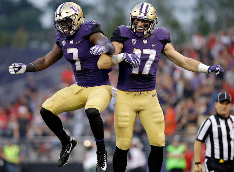 Washington's Tevis Bartlett (17) celebrates his interception against Fresno State with Keishawn Bierria (7) in the first half of an NCAA college football game Saturday, Sept. 16, 2017, in Seattle. Bartlett returned the interception 24 yards. (AP Photo/Elaine Thompson)