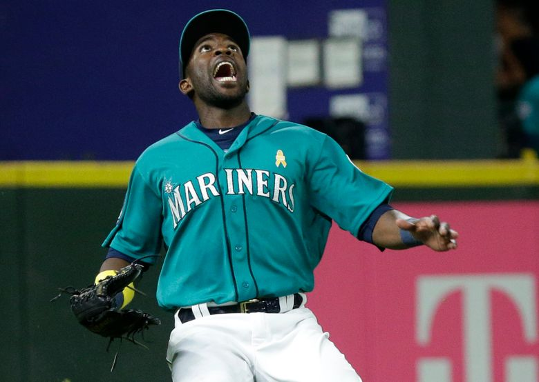 Seattle Mariners left fielder Guillermo Heredia yells as he positions himself to catch a fly ball hit by Oakland Athletics' Matt Olson to end the top of the eighth inning of a baseball game, Friday, Sept. 1, 2017, in Seattle.  (Ted S. Warren/AP)