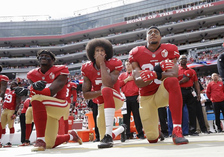 On Oct. 2, 2016 San Francisco 49ers outside linebacker Eli Harold, quarterback Colin Kaepernick and safety Eric Reid kneel during the national anthem before an NFL football game against the Dallas Cowboys in Santa Clara, Calif. (AP Photo/Marcio Jose Sanchez, File)