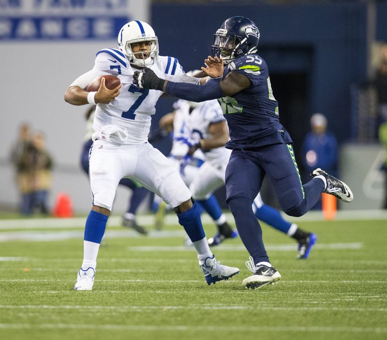 Seattle Seahawks defensive end Frank Clark (55) takes down Indianapolis Colts quarterback Jacoby Brissett (7) during 3rd quarter action last week. (Mike Siegel / The Seattle Times)