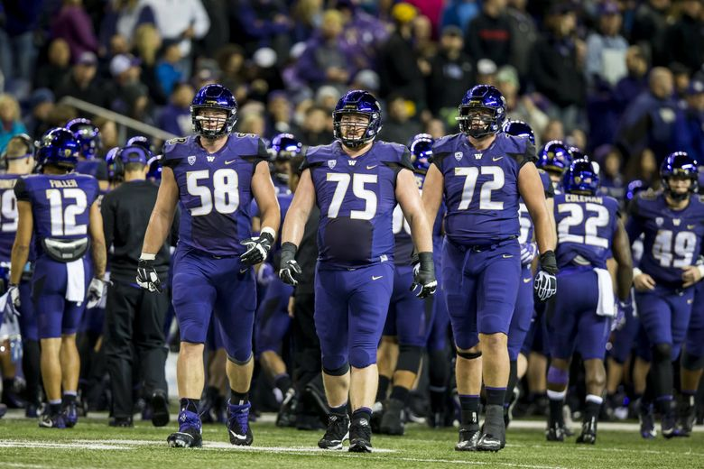 From left, Washington offensive lineman Kaleb McGary, Jesse Sosebee and Trey Adams take the field after a time out as the University of Washington Huskies take on the California Golden Bears at Husky Stadium in Seattle Saturday October 7, 2017. (Bettina Hansen / The Seattle Times)