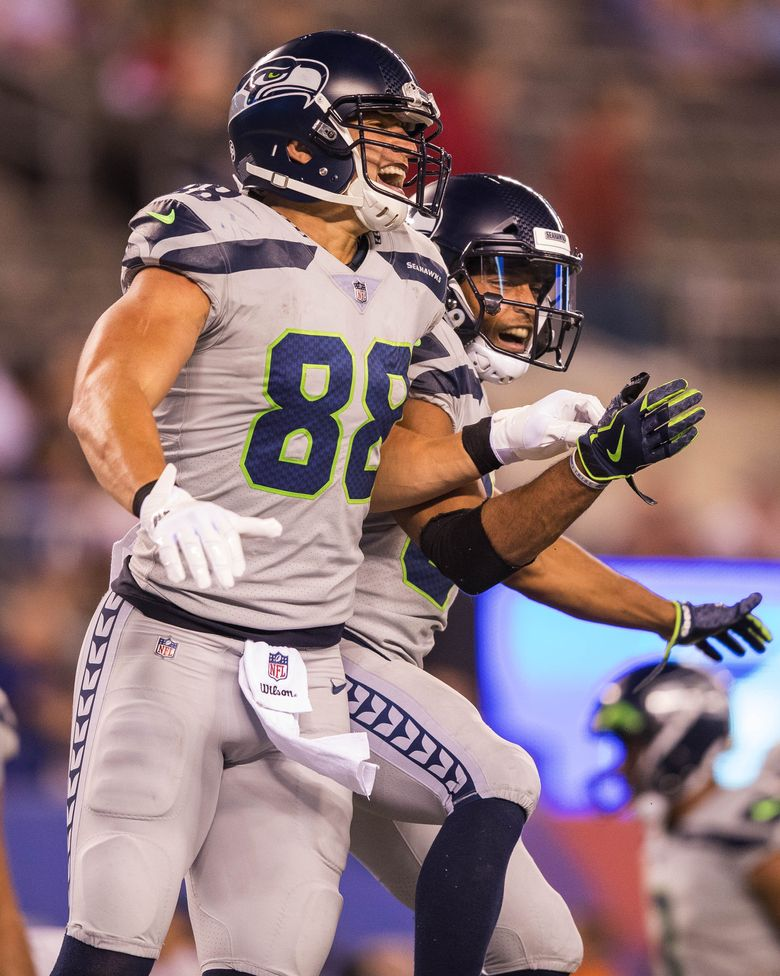 At the end of the day, though, Jimmy Graham and Doug Baldwin celebrate Graham's 1-yard TD. (Dean Rutz/The Seattle Times)