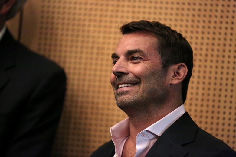 Chris Hansen of the Sonics Arena Investment Group smiles before speaking on the KeyArena and Sodo arena proposals in 2017.  (Courtney Pedroza/The Seattle Times)