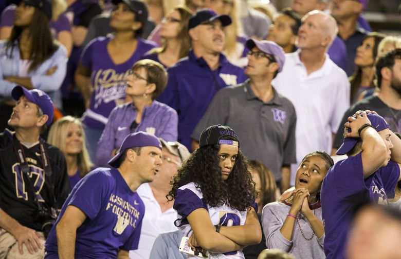 Washington fans react to Arizona State quarterback Manny Wilkins' 30-yard pass to Ceejhay French-Love, putting the Sun Devils at the 7-yard line with less than two minutes to go, as the University of Washington Huskies take on the Arizona State Sun Devils at Sun Devil Stadium in Tempe. (Bettina Hansen/The Seattle Times)
