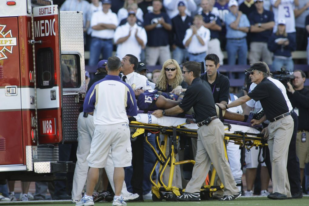 Washington free safety Darin Harris is loaded into an ambulance after his injury. (Ted S. Warren/Associated Press)
