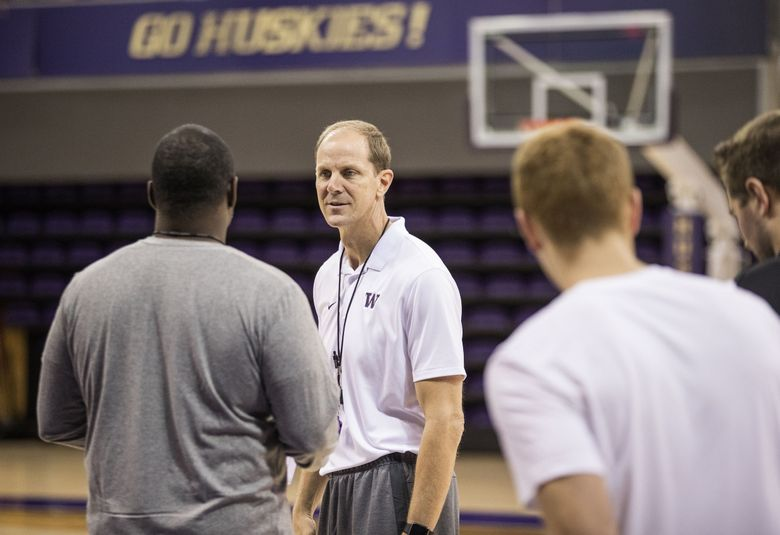 Coach Mike Hopkins takes over a UW men's basketball program that hasn't made the NCAA tournament since 2011. (Dean Rutz/The Seattle Times)