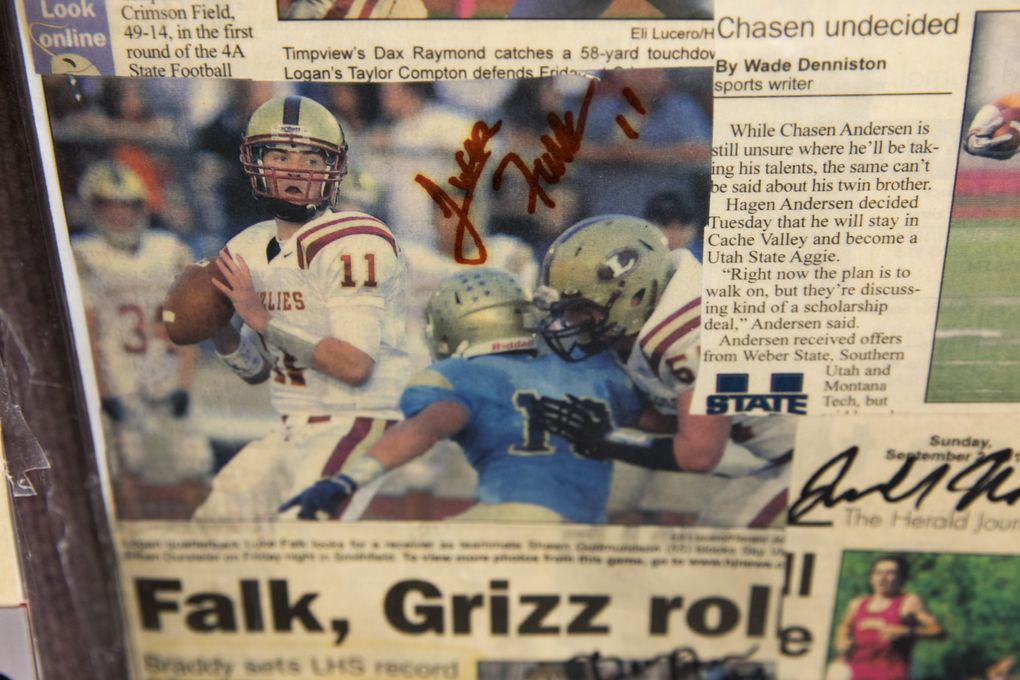 Luke Falk is the star in many of the old newspaper clippings in the classroom of Logan Brown, a teacher and basketball coach at Logan High School. Falk played basketball for Brown. (Bettina Hansen/The Seattle Times)
