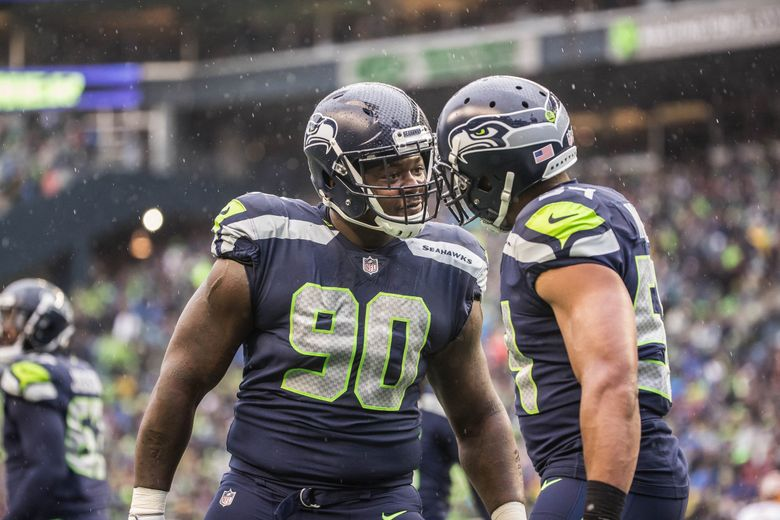 Jarran Reed gives Bobby Wagner that look following Wagners safety scored in the 1st quarter. (Dean Rutz / The Seattle Times)