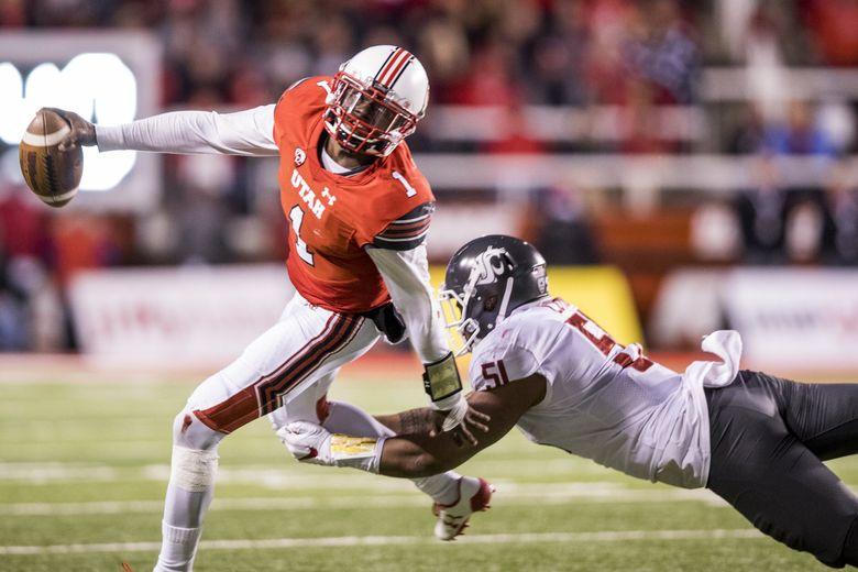 Washington State linebacker Frankie Luvu sacks Utah quarterback Tyler Huntley for a loss of seven yards. (Bettina Hansen / The Seattle Times)