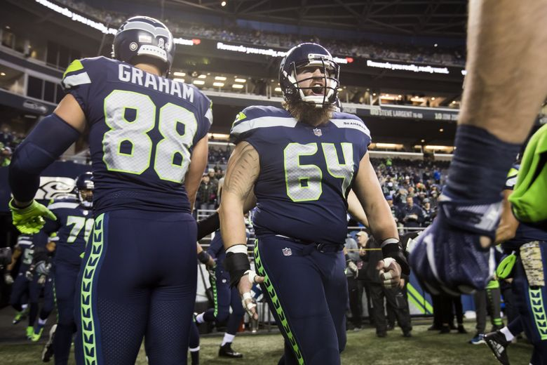 Seahawks offensive guard Jordan Roos lets out a yell before the Seattle Seahawks take on the Atlanta Falcons. (Bettina Hansen / The Seattle Times)