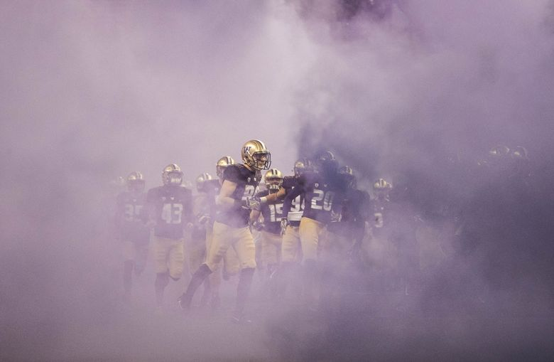 The Huskies come on to the field for Saturday's game with Oregon.  (Dean Rutz / The Seattle Times)