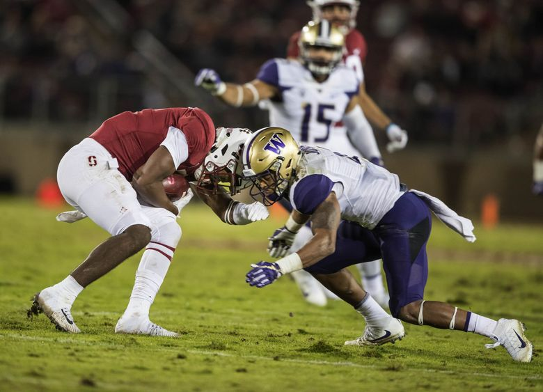 Austin Joyner goes head-to-head with Stanford's Connor Wedington, leading to a targeting penalty on the play, and an injury to Joyner.  The targeting penalty was overturned in review.  The Washington Huskies played Stanford Friday, November 10, 2017 at Stanford Stadium in Palo Alto, CA. 204115 (Dean Rutz / The Seattle Times)
