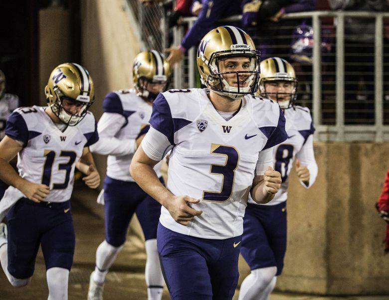 Jake Browning leads the 9th-ranked Washington Huskies out against Stanford Friday night.  (Dean Rutz / The Seattle Times)
