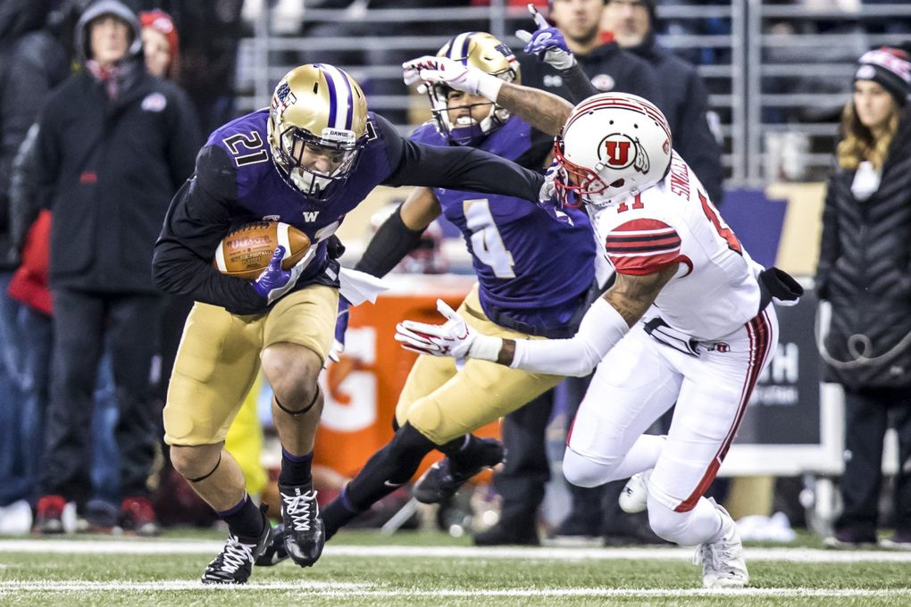 Huskies defensive back Taylor Rapp grabs an interception over Utes wide receiver Raelon Singleton in the second quarter as the University of Washington Huskies take on the University of Utah Utes at Husky Stadium in Seattle Saturday (Bettina Hansen / The Seattle Times)