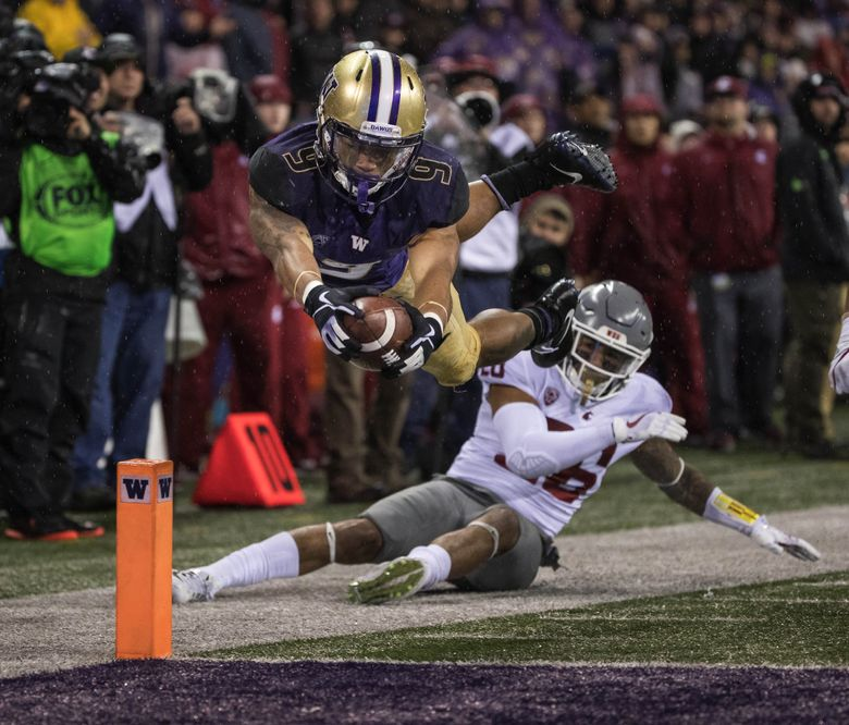 Myles Gaskin sails into the end zone scoring on a 26-yard touchdown in the 3rd quarter.  The Washington State Cougars played the Washington Huskies in the 2017 Apple Cup game at Husky Stadium Saturday, November 25, 2017. (Dean Rutz / The Seattle Times)