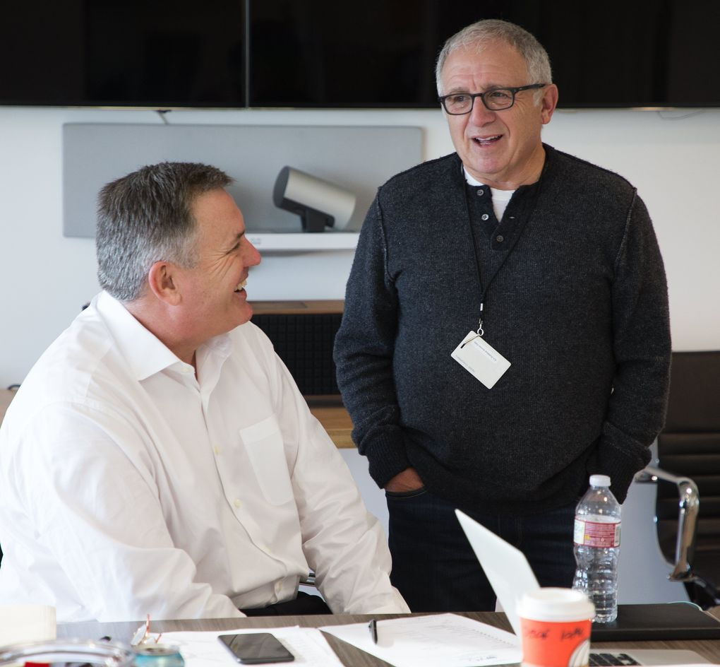 Oak View Group CEO Tim Leiweke, left, chats with Irving Azoff, entertainment executive and personal manager representing recording artists such as Christina Aguilera, The Eagles and Dan Fogelberg, in Leiweke's Westwood office in Los Angeles.  (Mike Siegel/The Seattle Times)