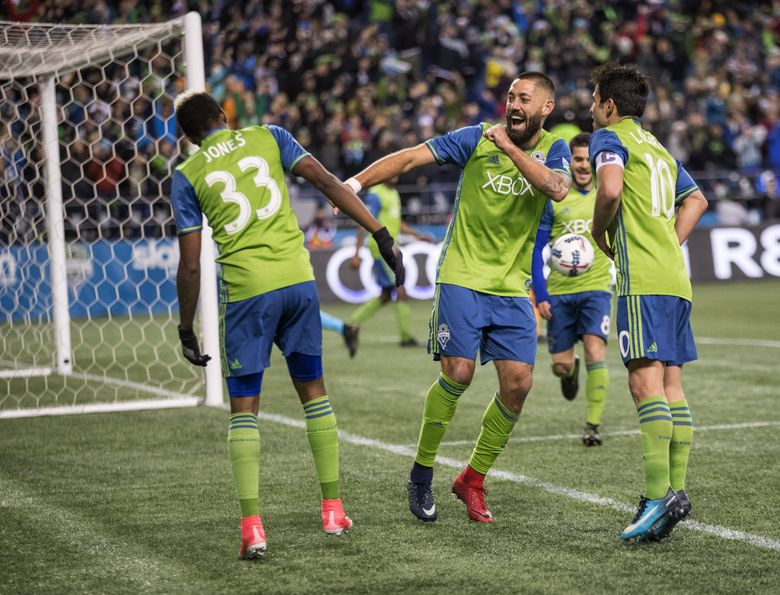 Clint Dempsey celebrates his second-half goal last week against Houston. Dempsey was one of six starters in that game that weren't on the field for last year's MLS Cup win in Toronto. (Dean Rutz/The Seattle Times)