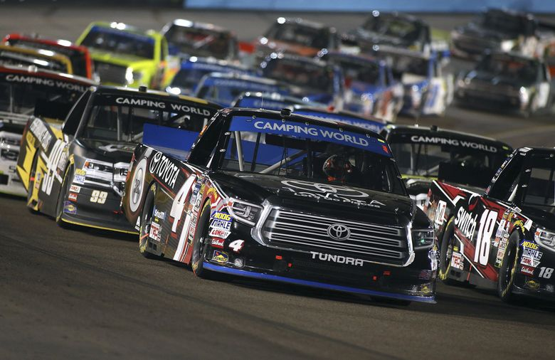 Christopher Bell (4) leads the field out of Turn 4 on a green flag restart during the NASCAR Trucks series auto race at Phoenix International Raceway, Friday, Nov. 10, 2017, in Avondale, Ariz. (AP Photo/Ralph Freso) NYOTK NYOTK (Ralph Freso / The Associated Press)