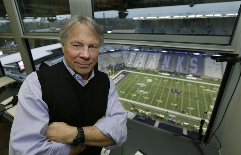 Bob Rondeau, who has been the Washington Huskies' announcer for the past 37 years, poses for a photo Saturday, Nov. 25, 2017, in Seattle before an NCAA college football game between Washington and Washington State, his last before he retires. (AP Photo/Ted S. Warren)