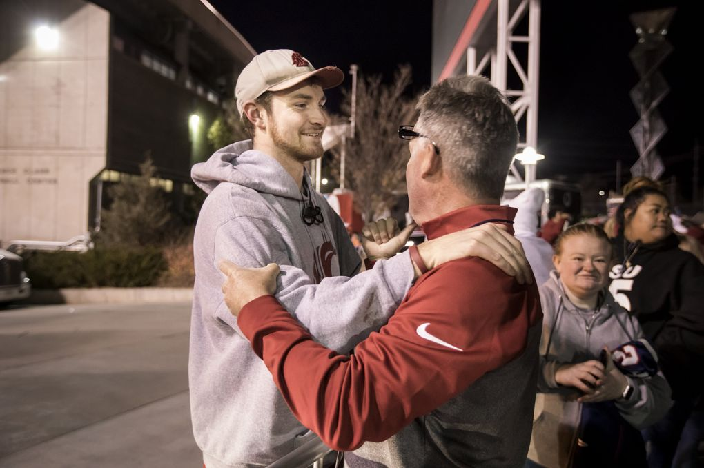 """Luke Falk greets his Logan High School football coach, Mike Favero, after Washington State beat Utah. """"It was very emotional for me to be able to see him play on that big stage,"""" Favero said. (Bettina Hansen/The Seattle Times)"""