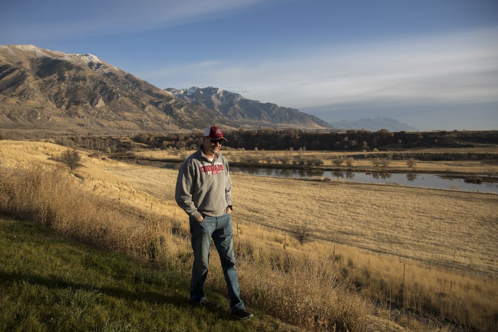 Jeff Anderson, Luke Falk's uncle, walks along his mother's property in Deweyville, Utah. The small town is where their ancestors settled in the 1800s, and where his nephew Luke Falk spent a lot of time as a kid, taking in this view of the Wellsville Mountains from his grandmother's house.  (Bettina Hansen/The Seattle Times)