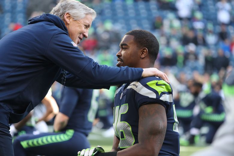 Pete Carroll talking to Tyrone Swoopes before a game in 2017. (Bettina Hansen / The Seattle Times)