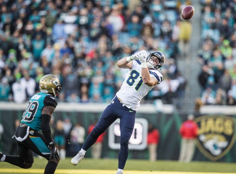 A first-down catch bounces off the hands of Nick Vannett in the first quarter Sunday. (Dean Rutz/The Seattle Times)