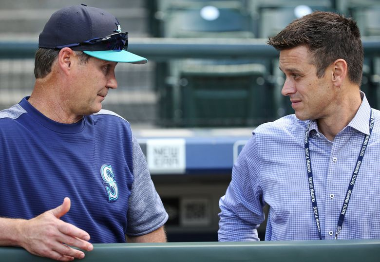 Mariners manger Scott Servais, left, and M's general manager Jerry Dipoto. (Ken Lambert / The Seattle Times)