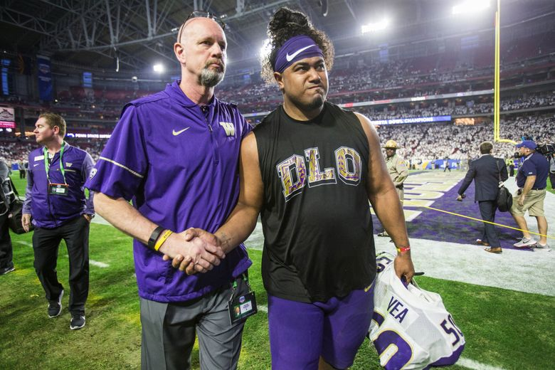 Vita Vea walks off the field after Washington lost to Penn State in the Fiesta Bowl 35-28. (Dean Rutz / The Seattle Times)
