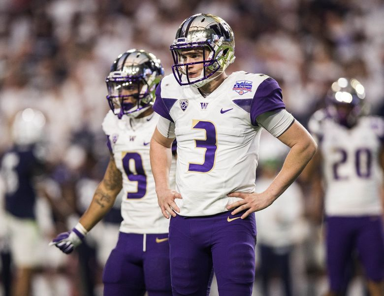 Jake Browning and Myles Gaskin look to the Husky sidelines in the fourth quarter. (Dean Rutz / The Seattle Times)
