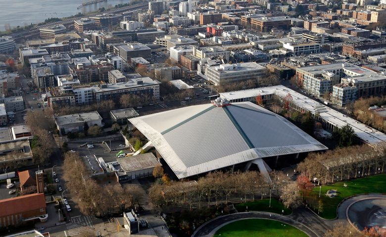 The iconic sloped roof of KeyArena, center, a sports and entertainment venue at the Seattle Center, is seen from above Monday, Dec. 4, 2017, in Seattle.  (Elaine Thompson/The Associated Press)