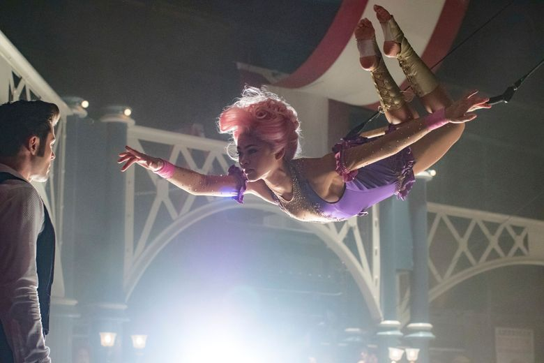 """Zendaya plays a trapeze artist in """"The Greatest Showman,"""" which also stars Zac Efron.  (Niko Tavernise/AP)"""