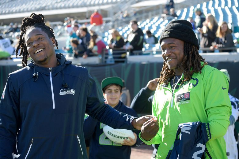 Seattle Seahawks cornerback Shaquill Griffin, left, talks with his brother, Central Florida linebacker Shaquem Griffin before Seattle's game at Jacksonville last season. (Phelan M. Ebenhack/The Associated Press)