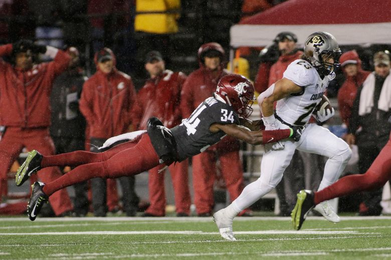 FILE – In this Oct. 21, 2017, file photo, Washington State safety Jalen Thompson (34) tackles Colorado running back Phillip Lindsay (23) during the first half of an NCAA college football game, in Pullman, Wash. Thompson was selected to the AP All-Conference Pac-12 team announced Thursday, Dec. 7, 2017. (AP Photo/Young Kwak, File)