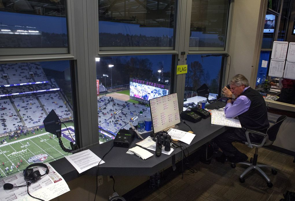 Bob Rondeau does game prep in his radio booth at Husky Stadium before the start of the Apple Cup where he  will be announcing his last game at Husky Stadium Saturday, November 25, 2017.  (Ellen M. Banner / The Seattle Times)