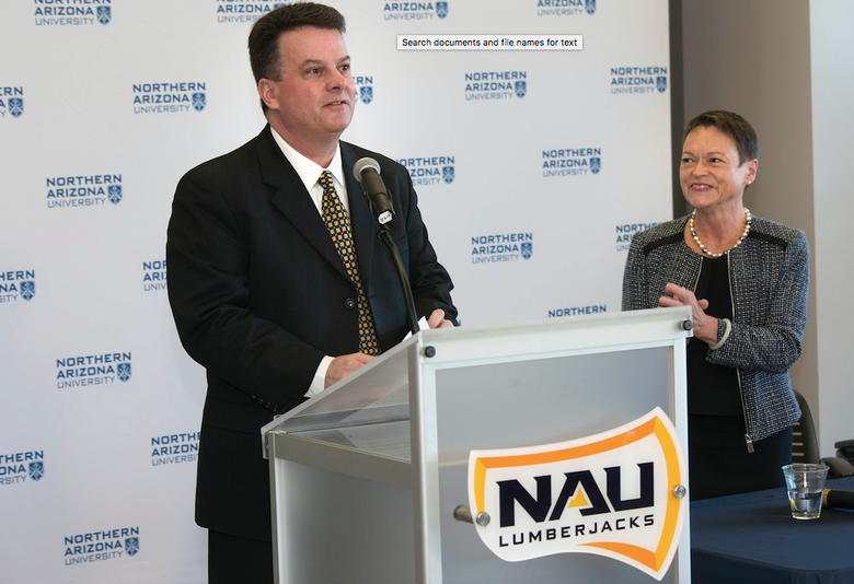 Washington State Deputy Director of Athletics Mike Marlow is introduced as the new athletic director at Northern Arizona University, as NAU President Rita Cheng (right) welcomes him. (Photo courtesy / Josh Biggs, Northern Arizona University)