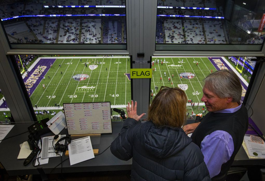 Bob Rondeau and his wife Molly chat in his radio booth before he announces his last game at Husky Stadium — the Apple Cup — Saturday, November 25, 2017.  (Ellen M. Banner / The Seattle Times)